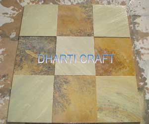 Mint color sandstone paving slabs with natural fossil on it