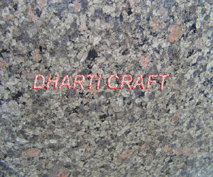 light green color granite with dots of black, pink and white